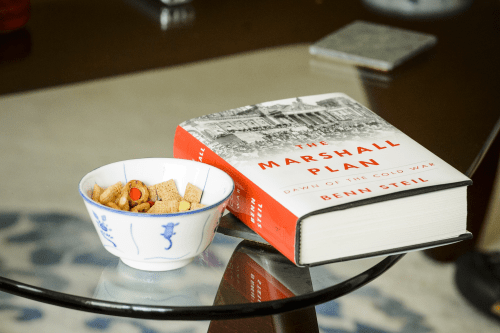 Photo: Book on table next to a small bowl of Chex Mix