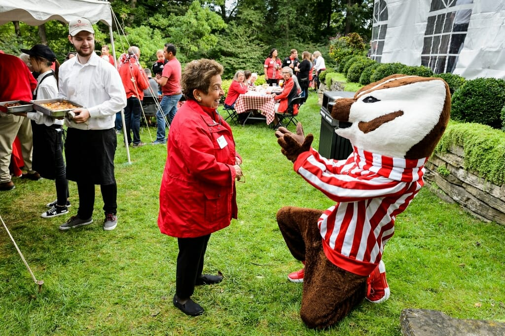 Photo of Bucky Badger welcoming Donna Shalala back to Olin House, the official residence of the chancellor, during a tailgate party Sept. 8. Shalala, who served as chancellor from 1988 to 1993, returned to campus for her induction into the UW Athletic Hall of Fame.