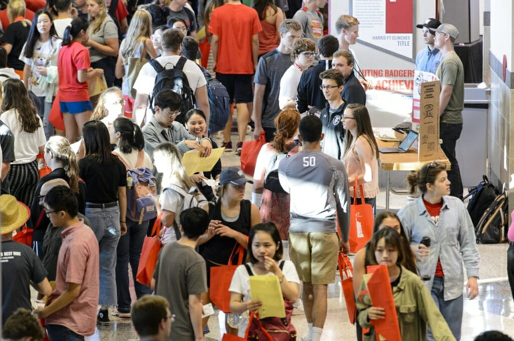 Students walk through the Kohl Center during the Fall Student Organization Fair.