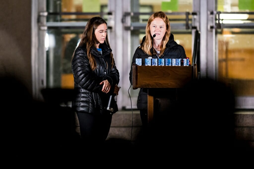 Photo of Olivia O'Connor, a student from Pittsburgh, reading the names of the 11 victims.