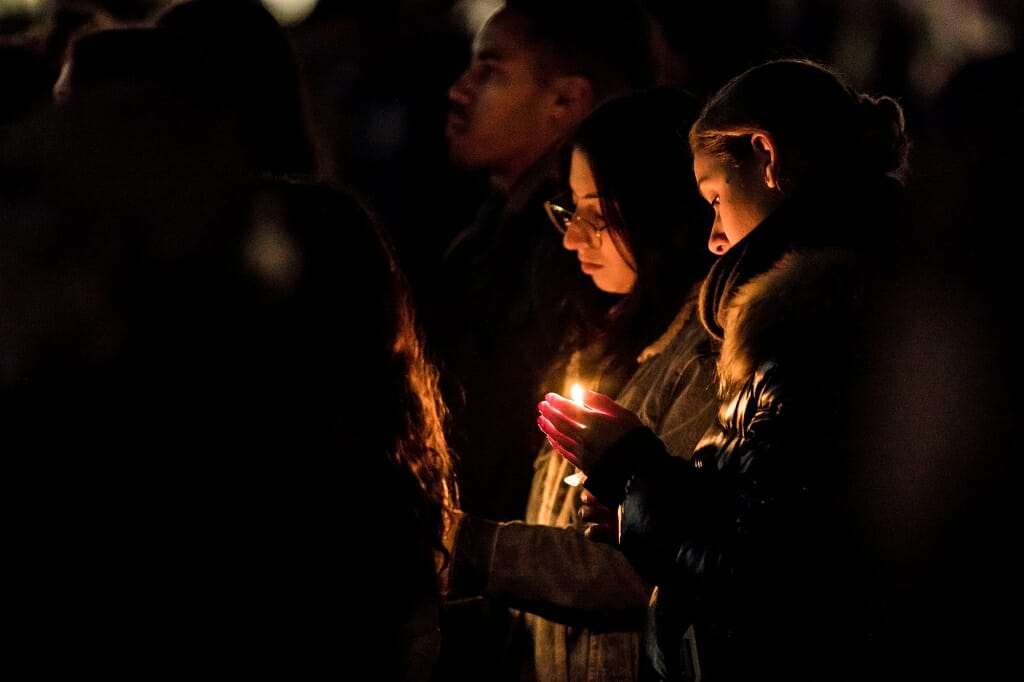 Photo of students holding candles.