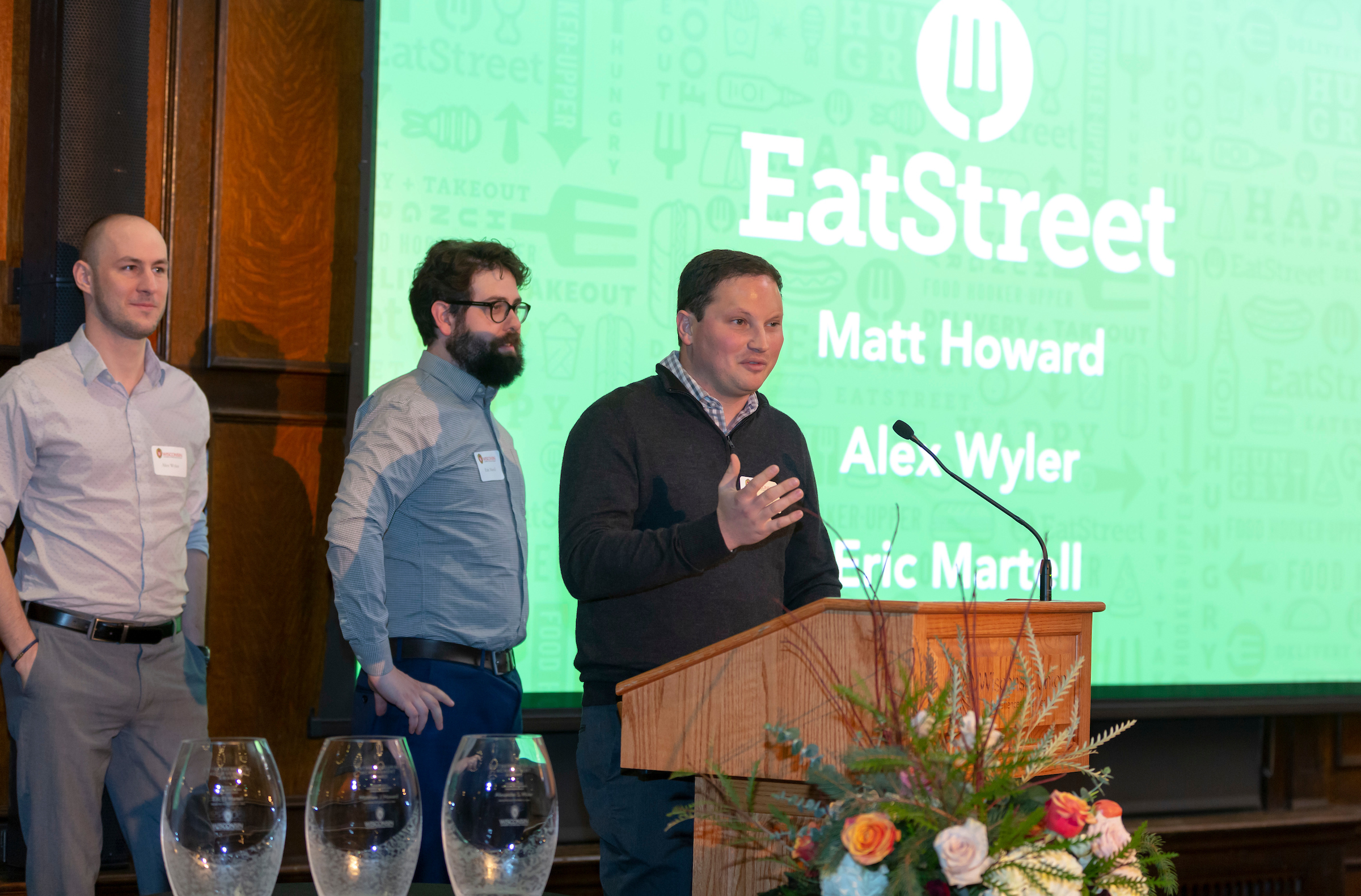 Photo of EatStreet CEO Matt Howard accepting the 2018 Entrepreneurial Achievement Awards on Nov. 14 with co-founders (from left) Alex Wyler and Eric Martell.