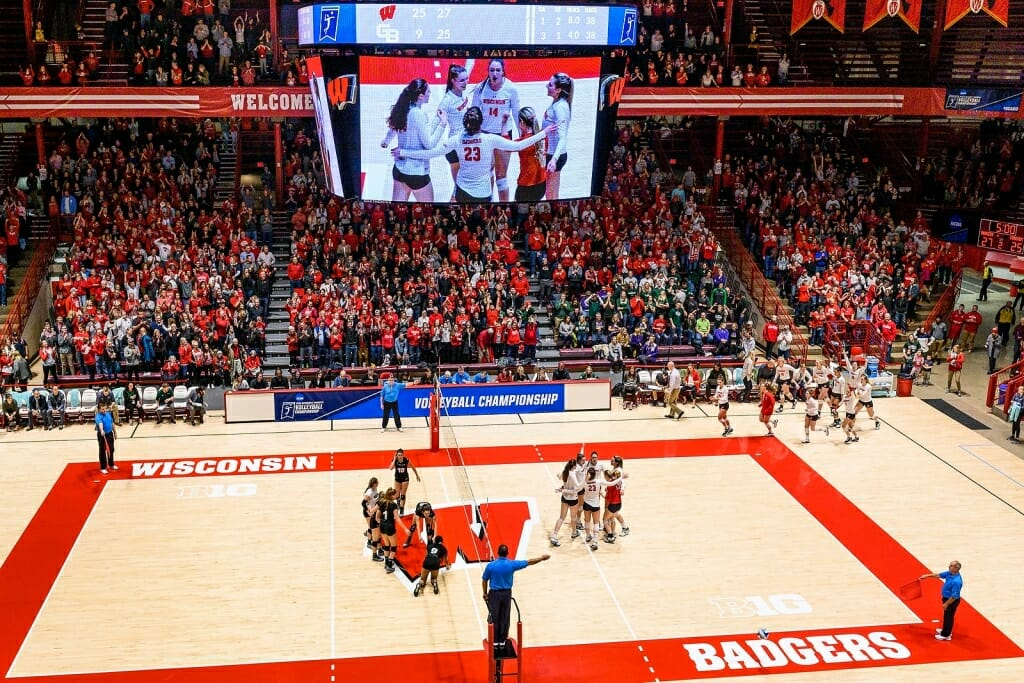 A view of the entire court after a win over Green Bay. The Badger players are gathered in celebration as the Phoenix players wait for the handshake.