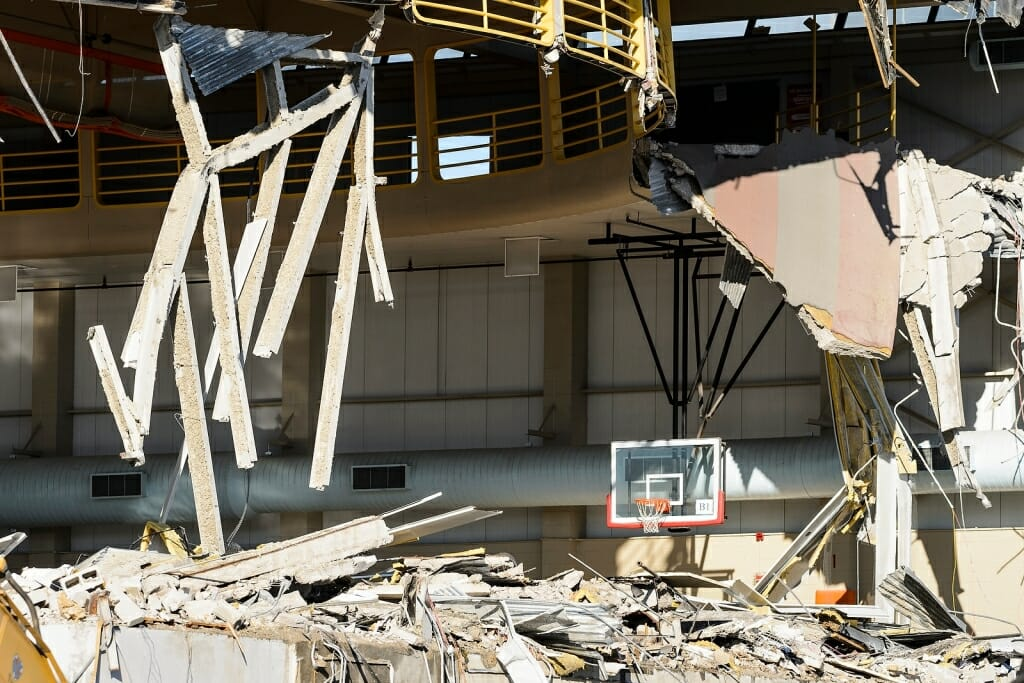 Photo: Debris from demolished gymnasium with basketball hoop still standing