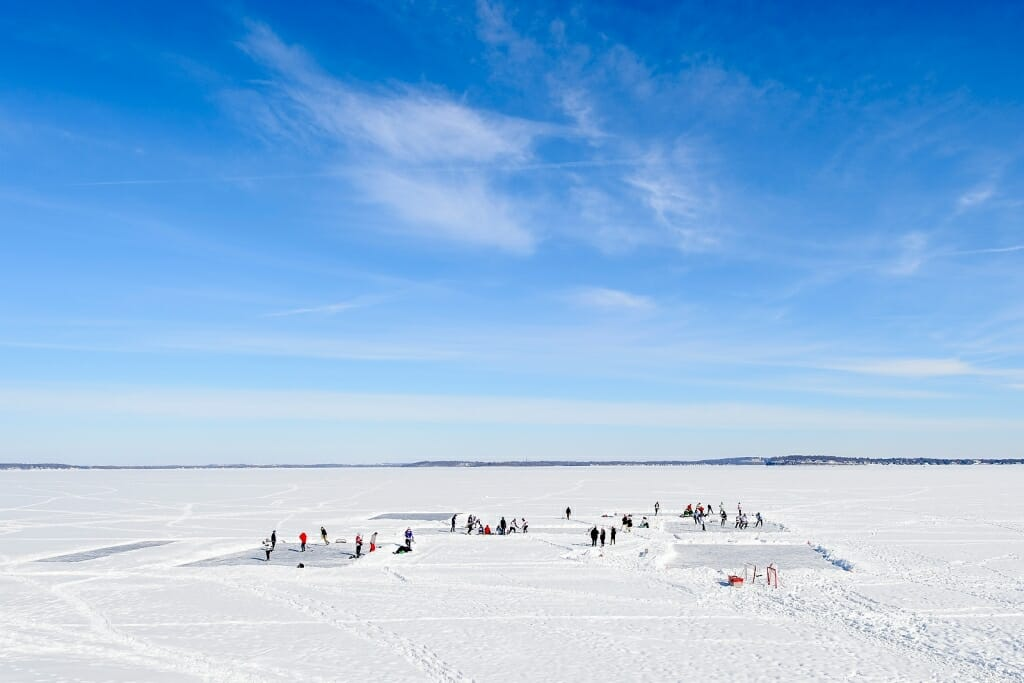 Photo: People playing hockey on frozen lake