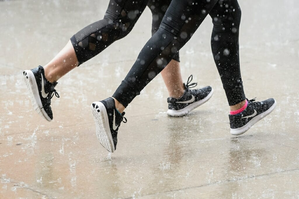 Photo: Closeup of legs of joggers moving in unison