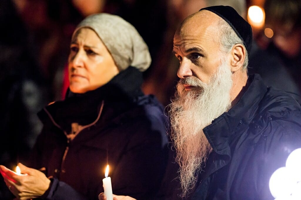 Photo: Rabbi holding lighted candle