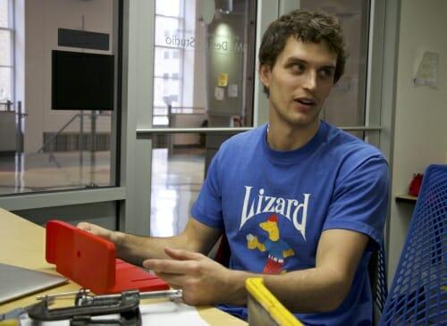 Photo: Student holding device