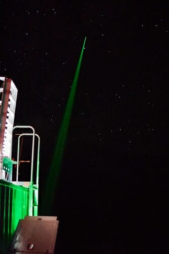 Photo: Time-exposure photo of laser beam aimed into space