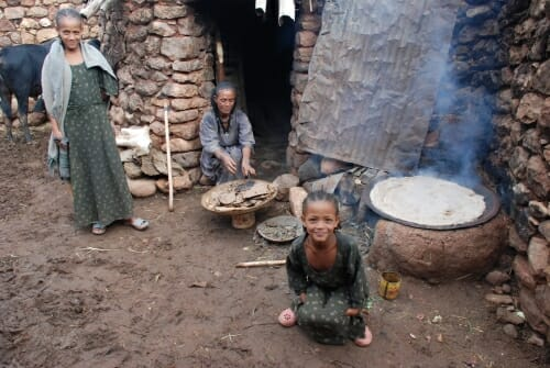 Photo: People gathered around a stove