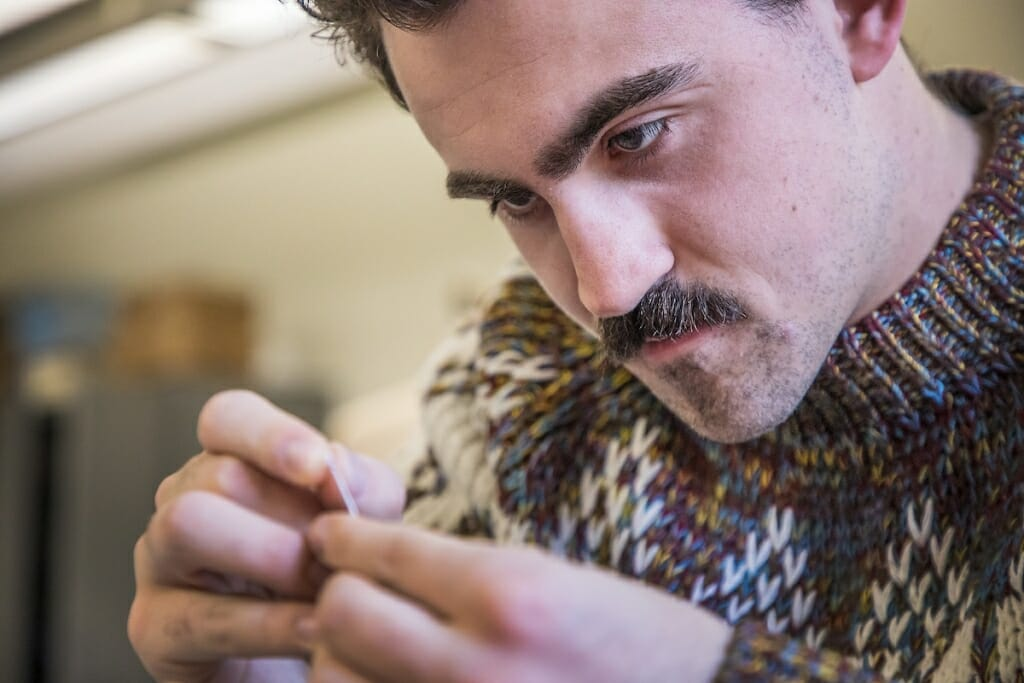 Photo: Griffin Claes working on a sewing project