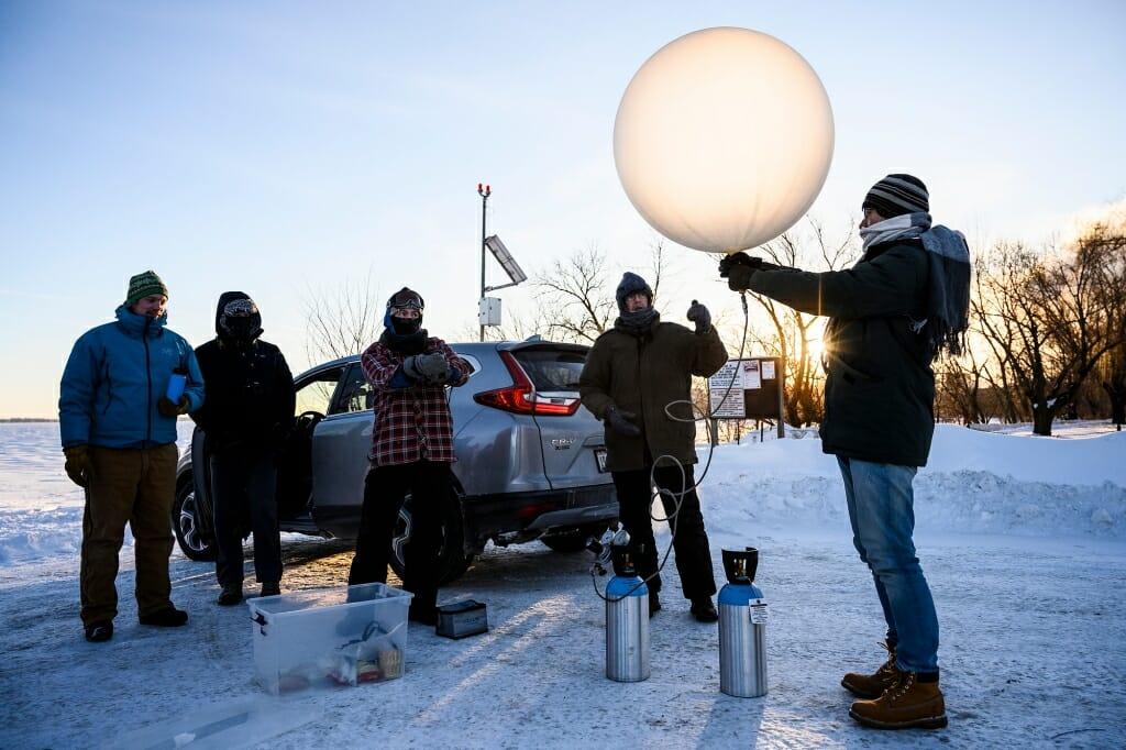 On the second of two unusually cold days in Madison, Petty gathered with a group of students and colleague Ankur Desai at sunrise on University Bay. Temperatures hovered around minus 24-degrees Fahrenheit. They filled a weather balloon with helium in preparation to gather measurements of temperature and humidity for several miles above Earth's surface.