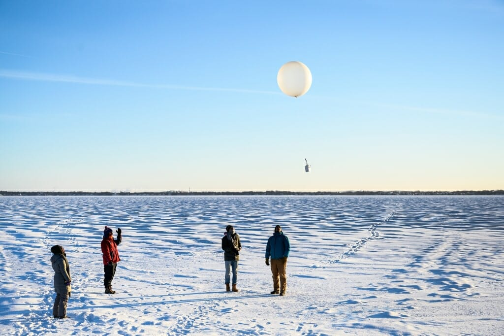 Upon the signal from Petty, the students released the weather balloon carrying the radiosonde. Petty immediately began to capture data from the instrument, which he could see on his computer. The balloon would travel as high as 20 miles above Earth's surface and as far away as 100-miles before bursting and returning to the ground. The radiosonde would continue to transmit data, which Petty would analyze later to determine atmospheric conditions above Madison on an unusually cold winter day.