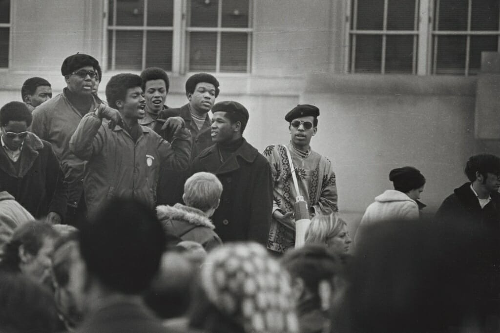 Photo of some of the leaders of the Black Student Strike of 1969 gather to speak at a rally.