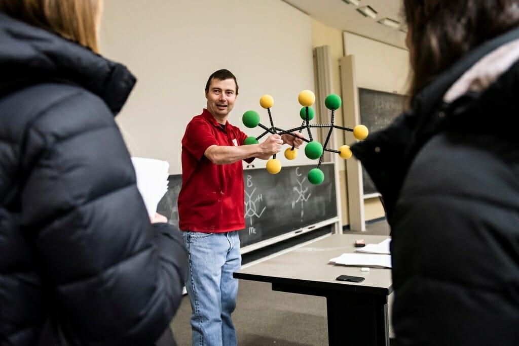Photo: Matt holding model of a molecule