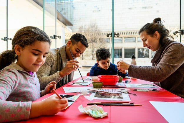 Yandri Delgado Villamil and Martina Kunović create art side by side with their children, Noa, 8, and Sammy, 10, Delgado Villamil is a staff member with UW-Madison's Facilities Planning and Management, and Kunović is a graduate student and instructor in sociology.