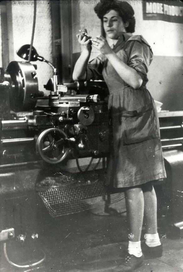 Photo: Thelma Estrin working on engineering equipment