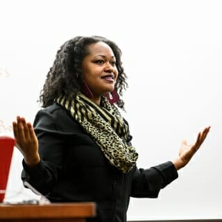 <strong>Bianca Baldridge</strong>, assistant professor of educational policy studies<br> Excellence in Community-Based Learning Award <br><br><i>Bianca Baldridge lectures to students during her Education Policy 210: Youth, Education and Society class in the Education Building.</i><br><br>Baldridge is deeply committed to critically examining and engaging community-based educational spaces and engaging black youth within marginalized communities. She embraces, exemplifies and models the importance of combining scholarship and activism to work toward social justice through her ongoing engagement with her students and local communities, and direct work with youth and youth workers across Madison. Baldridge intentionally makes space in her curriculum to include the voices of community members. She encourages students to attend community events and invites guest speakers from the community to contribute to classroom discussions. In addition, she creates learning environments that foster critical reflections and dialogue around ethnicity, power and oppressions, and the intersections of race, class, gender and sexuality. Her students are encouraged to engage in self-reflective practices and deconstruct normative ideas and practices. Baldridge encourages a culture of reflection in the classroom that fosters patience with the learning process and kindness to self and others while mindfully nudging students to expand boundaries that limit their ways of thinking, knowing and seeing the world.