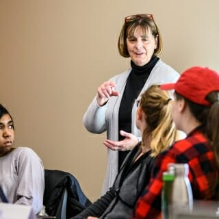 <strong>Lisa Bratzke</strong>, assistant professor of nursing<br> Van Hise Outreach Award <br><br><i>Lisa Bratzke talks with students during her Nursing 679: Honors Research Seminar in Signe Skott Cooper Hall.</i><br><br>Bratzke developed and initially taught Nursing 590/511 Community Supports for Persons with Dementia as an overload course. Largely due to the success and popularity of the course, it has become part of her regular teaching assignment and has gained permanent course status. She led a small group of faculty in writing and submitting a grant proposal to the Bader Foundation to develop a Dementia Friendly Toolkit.  The toolkit includes videos and simulations that enable participants to experience both having dementia and caring for someone with dementia. It has been widely distributed throughout Madison and surrounding communities and is used to train students in multiple professional disciplines on campus. She ensures that students are introduced to techniques to communicate clearly and respectfully with people living with dementia. Bratzke builds upon this foundation with readings and discussions on the personhood of people living with dementia, as well as health inequities and dementia and caregiving experiences across different racial and ethnic communities.