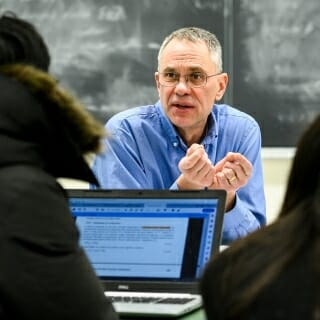 <strong>Mark Ediger</strong>, professor of chemistry<br> Chancellor's Distinguished Teaching Award <br><br><i>Mark Ediger talks with students during his Chem 664: Physical Chemistry of Macromolecules course in the Chemistry Building.</i><br><br>Ediger views his efforts holistically, always striving to connect with students and blend rigor with compassion. He has served as a mentor and role model for thousands of high school and college students who cherish him for his extraordinary dedication to teaching. Faculty have benefited greatly from his insights into graduate student mentoring and his full speed ahead efforts to improve diversity and enhance our sense of community. He takes time to answer clarifying questions from students in order to help them better understand the material. An important aspect of his teaching style is always the connection of the concepts to real life, whether that's climate change or energy production on campus. It helps keep students engaged and informed about what chemistry looks like outside the classroom — something especially important for an introductory class.