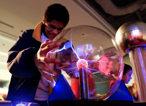 Photo: Student touching clear globe