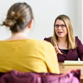 <strong>Kristin Shutts</strong>, associate professor of psychology <br>William H. Kiekhofer Award <br><br><i>Kristin Shutts talks with a group of graduate students during a lab meeting in the Brogden Psychology Building.</i><br><br>Shutts seeks to generate student engagement by making the learning material relevant to them. Extant research shows that when students see value in material, they work harder and learn more deeply. Shutts strives to achieve relevance in multiple ways. For example, in her large lecture course, she asks every one of her more than 100 students to turn in a response card at the end of every lecture noting either what they found most interesting, what they wish she had talked more about, and what remaining questions they have about the day's lecture topic. She identifies common themes in response cards and uses them to enrich lectures for the next time she teaches. Shutts stands out for her ability to push students to go far beyond where they started, tackling sensitive and challenging issues and, in doing so, building critical thinking skills that will benefit her students long after they leave our campus.