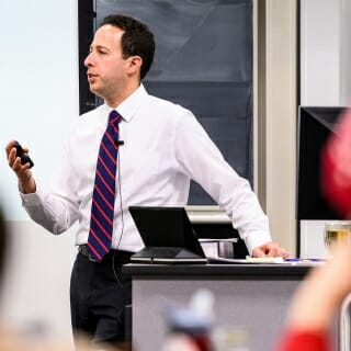 <strong>Rob Yablon</strong>, assistant professor of law<br> Emil H. Steiger Award <br><br><i>Robert Yablon teaches a Law 824 – Federal Jurisdiction class in the Law Building.</i><br><br>Since joining the Law School in 2004, Yablon has made a big impact. In 2017, he was named Law School Teacher of the Year. He uses a mix of teaching methodologies, all to good effect. And he does it with a good mastery of the material and an ability to make the material clear and accessible for students. His courses, particularly the Law of Democracy and its focus on voting rights, contains sometimes-controversial material on the current U.S. political landscape and its interplay with legal developments. While these subjects have the potential to alienate students who disagree with each other and have a chilling effect on participation, Yablon has a particular ability to generate inclusive conversation on politically charged topics. The resulting discussions encourage students to probe thoughtfully into the broader ideas at stake. He is a natural teacher whose manner of speaking and thinking are ideally suited to the exploration of complex legal and political issues in the classroom.