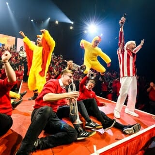 Under Leckrone's direction, band members enthusiastically lead the audience in a performance of the