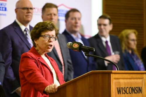 Photo: Blank speaking at podium