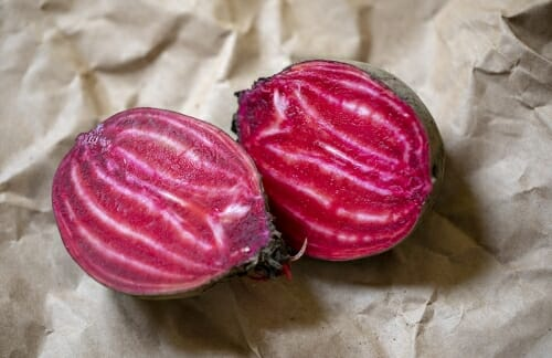 Photo: Two beets lying on a table.