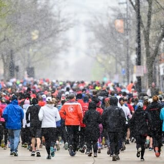 Despite the dire forecasts, the snow was not much more than some cool dampness in the face of runners.