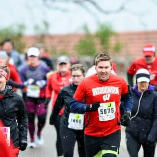 Snowy, cold weather didn't prevent runners from showing up en masse for the popular race.