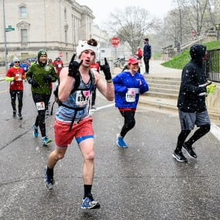 Neither the snow, nor Observatory Drive hill, dampened the spirits of these participants.