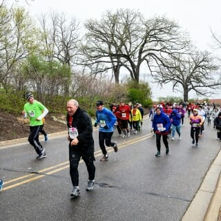 Runners tackle Observatory Drive Hill with enthusiasm.