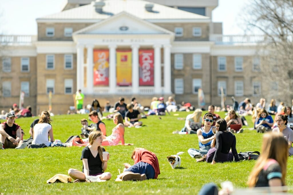 Photo: Students sitting and lying in grass