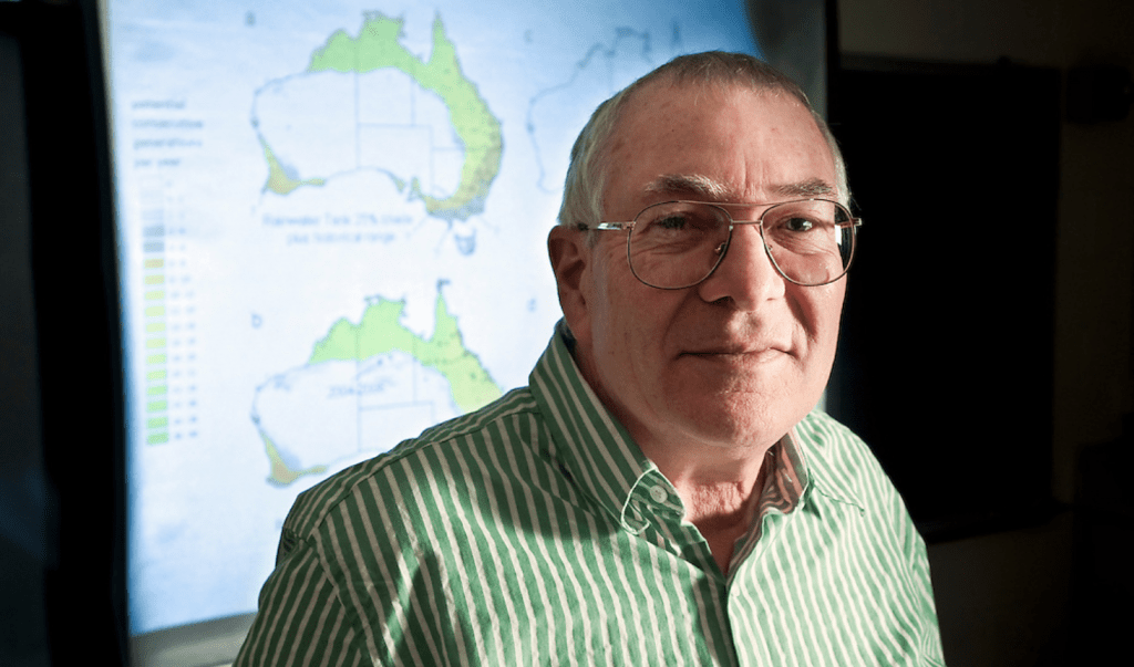 University of Wisconsin–Madison Professor of Zoology, Warren Porter, is pictured in front of a projected map of Australia showing possible future habitat for the mosquito that carries dengue fever. Using software models to predict the spread of the human disease vector, Porter's research team has found that a combination of climate change, evolutionary change, and human behavior are likely to expand the mosquito's range over the next 40 years, increasing the risk of disease transmission.