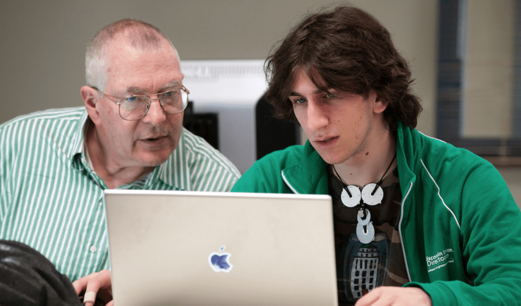 Undergraduate David Michaels (right), a first-year student studying engineering physics, works on his laptop in a computer lab in the Computer-Aided Engineering Center at the University of Wisconsin–Madison. Michaels is working on research with Porter and using computer-modeled data to study the hydrodynamics of leatherback sea turtles.