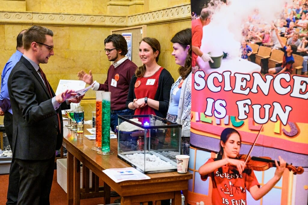 Photo: Students standing next to Science is Fun sign