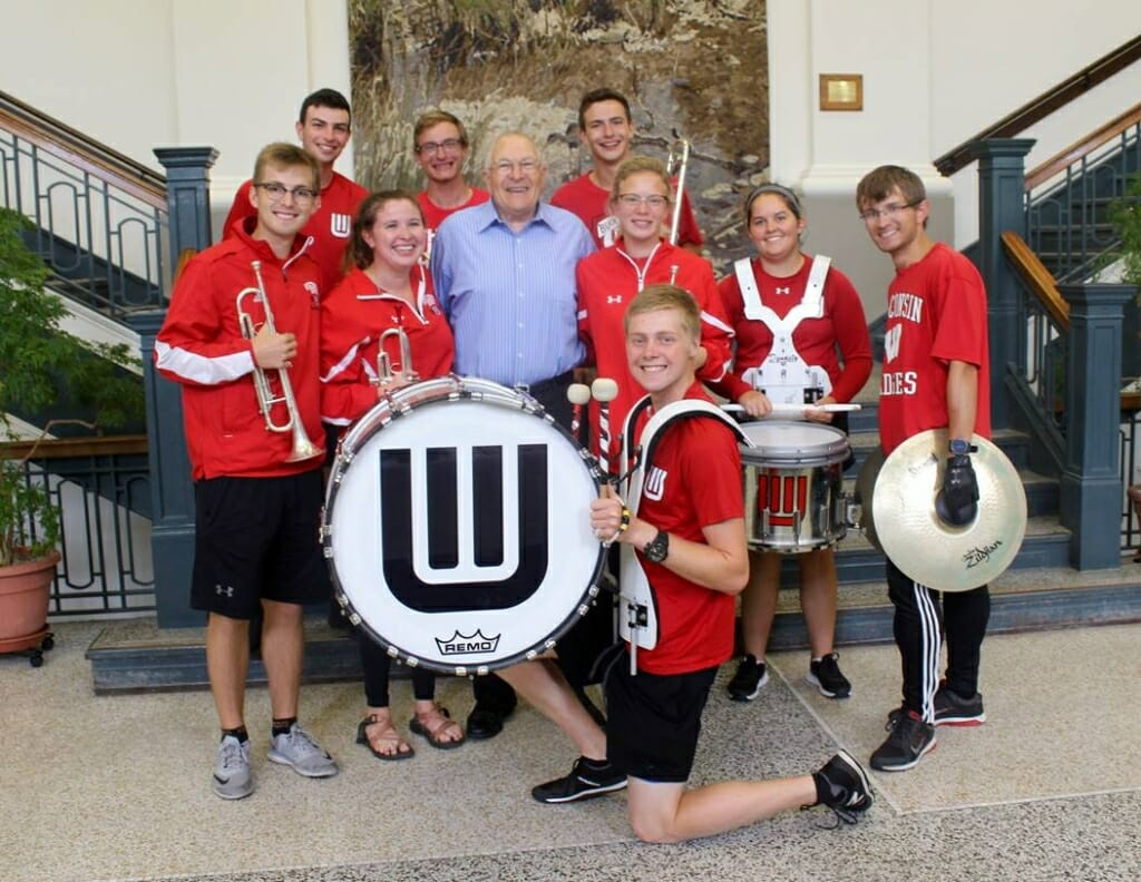 Warren Porter poses with members of the UW Marching Band.