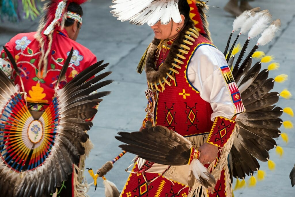 Photo: Costumed dancer taking part in Grand Entry