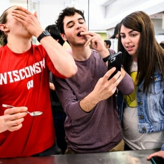 From left to right, Will Northway, Emon Khadem and Morgan Eisenstein take a selfie while sampling dried insects.