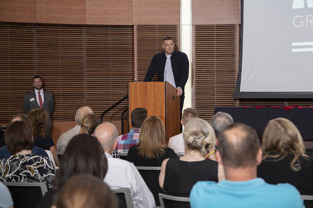 Photo of J.J. Watt speaking at podium.