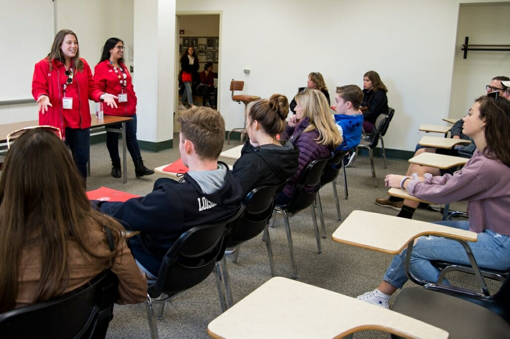 During an autumn tour, student guides Savi Lurie (left) and Jinan Sous (right) from Campus and Visitor Relations (CAVR) show prospective students and guests around the University of Wisconsin–Madison campus classrooms on Oct. 18, 2018. (Photo by Lauren Justice / UW–Madison)