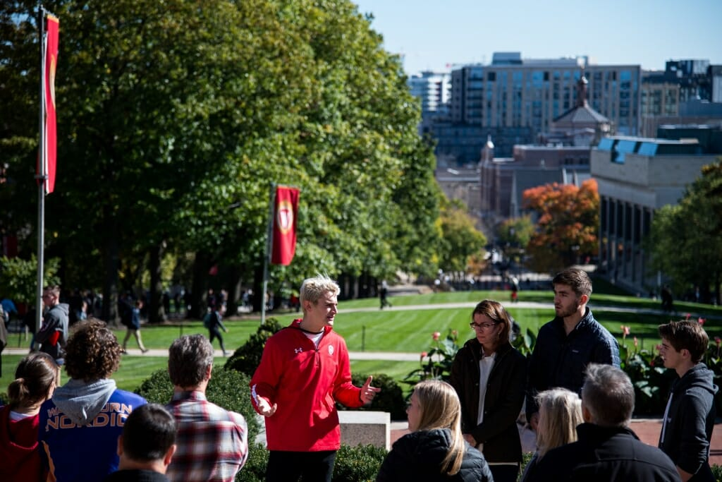 During an autumn tour, student guide Brandon Steer from Campus and Visitor Relations (CAVR), shows prospective students, family, and guests around campus at the top of Bascom Hill at the University of Wisconsin–Madison on Oct. 18, 2018. Visitors can see down State Street to the capitol building from the top of Bascom Hill.(Photo by Lauren Justice / UW–Madison)