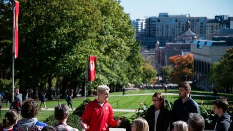 During an autumn tour, student guide Brandon Steer from Campus and Visitor Relations (CAVR), shows prospective students, family, and guests around campus at the top of Bascom Hill at the University of Wisconsin-Madison on Oct. 18, 2018. Visitors can see down State Street to the capitol building from the top of Bascom Hill.(Photo by Lauren Justice / UW-Madison)