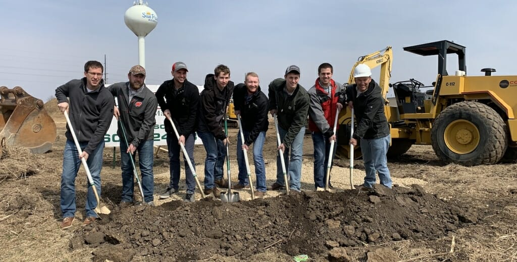 Photo: A group of men pose with shovels at a groundbreaking.
