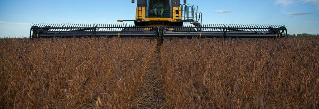 Photo: A harvester rolls through a wheat field.