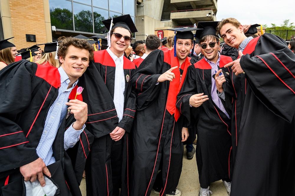 Photo of graduates posing outside Camp Randall.