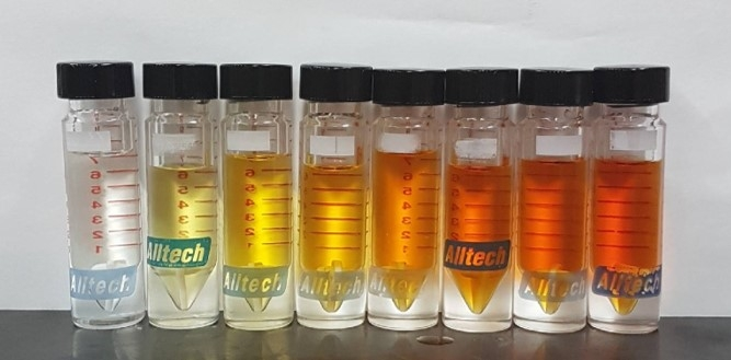 Photo: Vials lined up with increasingly orange chemicals in them