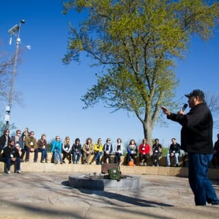 13 May, 2019.  Bill Quackenbush, the Tribal Historic Preservation Officer for the Ho-Chunk Nation, leads the 2019 Wisconsin Idea Seminar on a special cultural landscape walking tour that culminated at the tip of Picnic Point. (Photo by Catherine Reiland/UW-Madison)